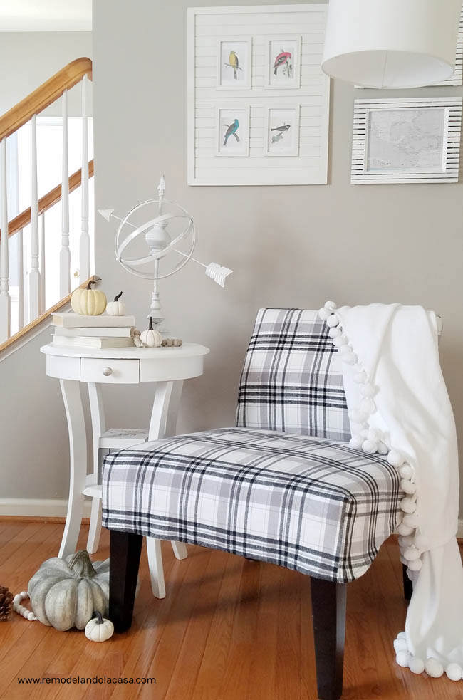 white side table, armillary sphere, pom pom white throw blanket, white pumpkins, steps, grey wall