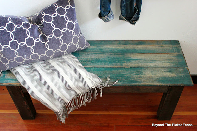 farmhouse style bench with teal paint and dark stain