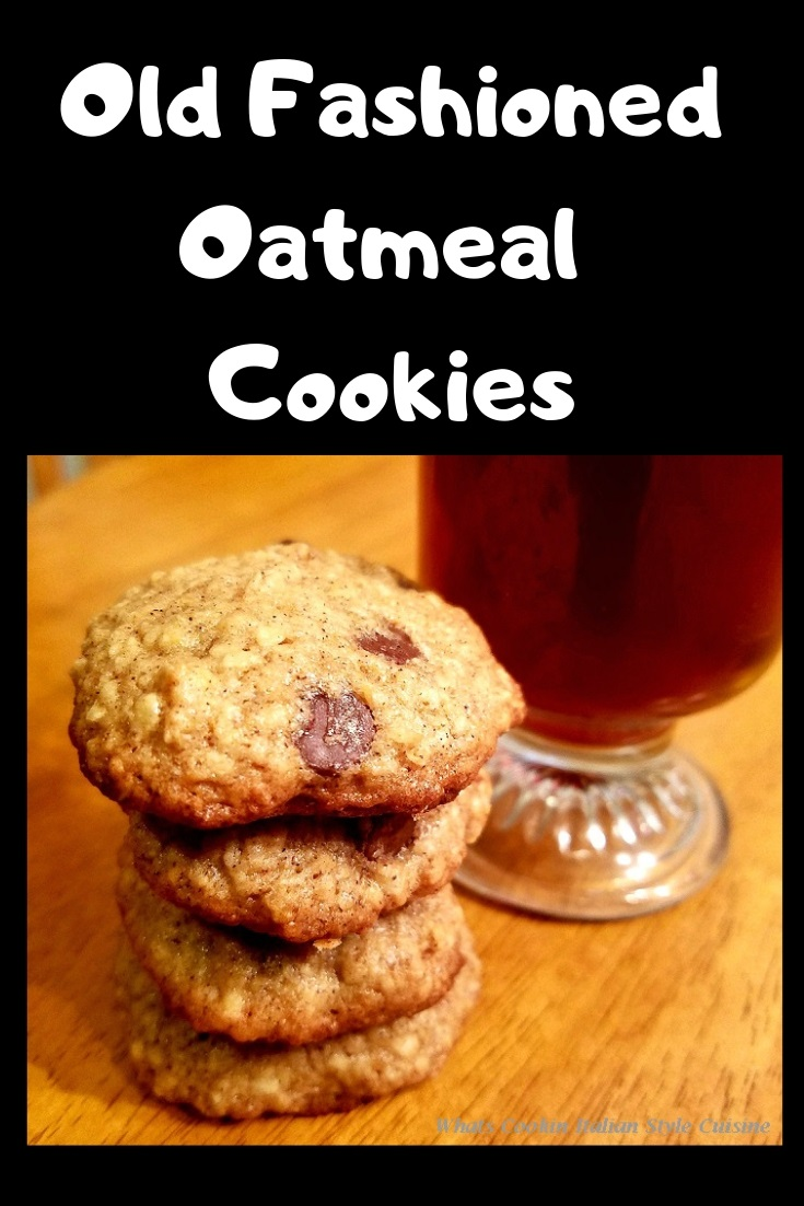 Old fashioned oatmeal cookies with chocolate chips and a hot cup of strong coffee