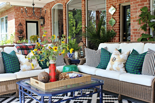 outdoor living area, patio, plaid pillows, fall decorations