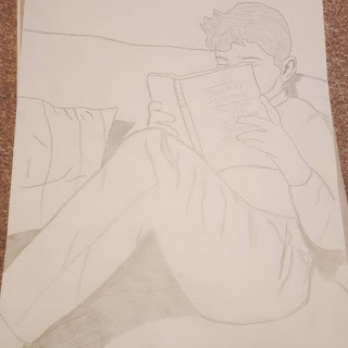 a drawing of Dan Jon Jr reading his Scriptures