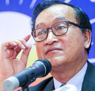 Opposition leader Sam Rainsy said Prime Minister Hun Sen is a coward and dared not allow him to return to Cambodia.