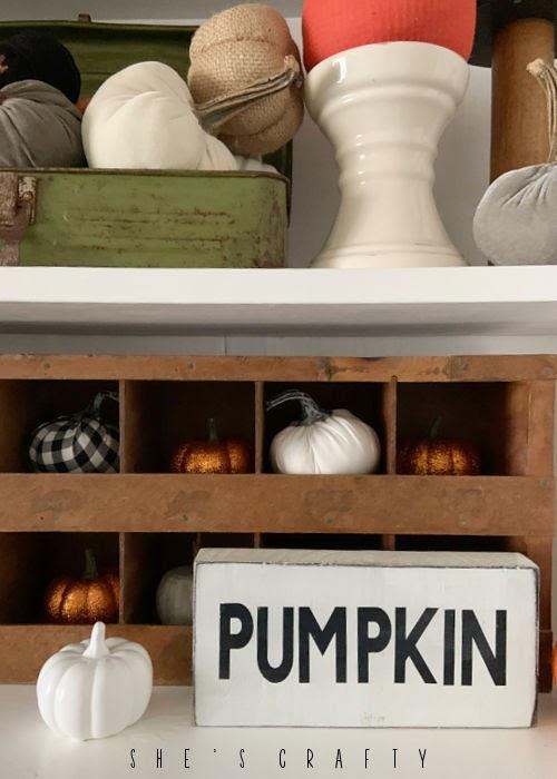 Handmade Pumpkin Sign in Fall hutch vignette.