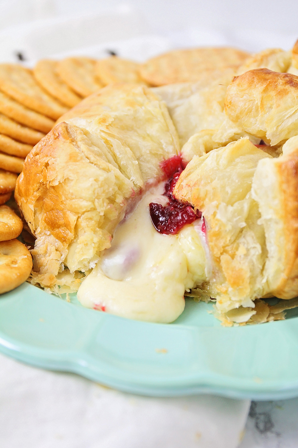 This gooey and melty cranberry baked brie is the perfect party appetizer, and so easy to make!