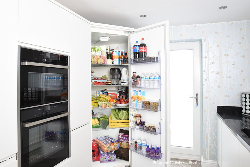 large fridge with door ope full of food