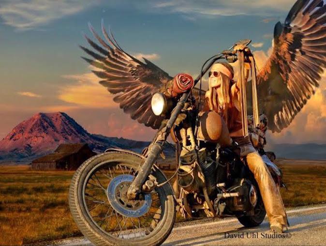 Happy Mutant Eagle Girl sits astride an old Harley Davidson Rat Bike in a landscape resembling the Old West.