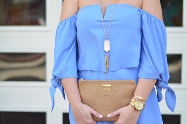 Up close detail shot of Kendra Scott necklace and GiGi New York clutch.