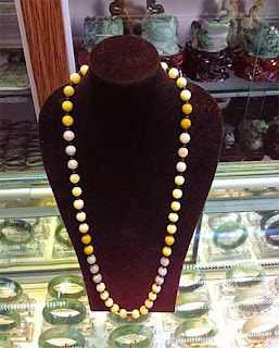 Beaded jadeite chains in the yellow color spectrum