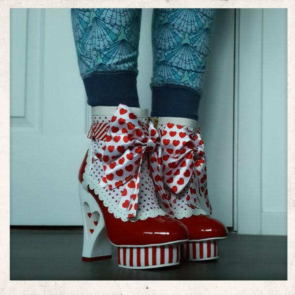 wearing irregular choice red rosie with love ankle boot