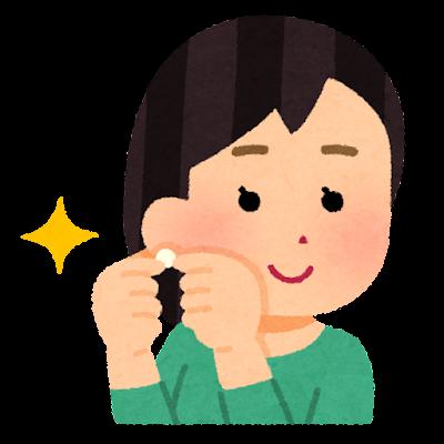 耳飾りを付ける人のイラスト(女性)