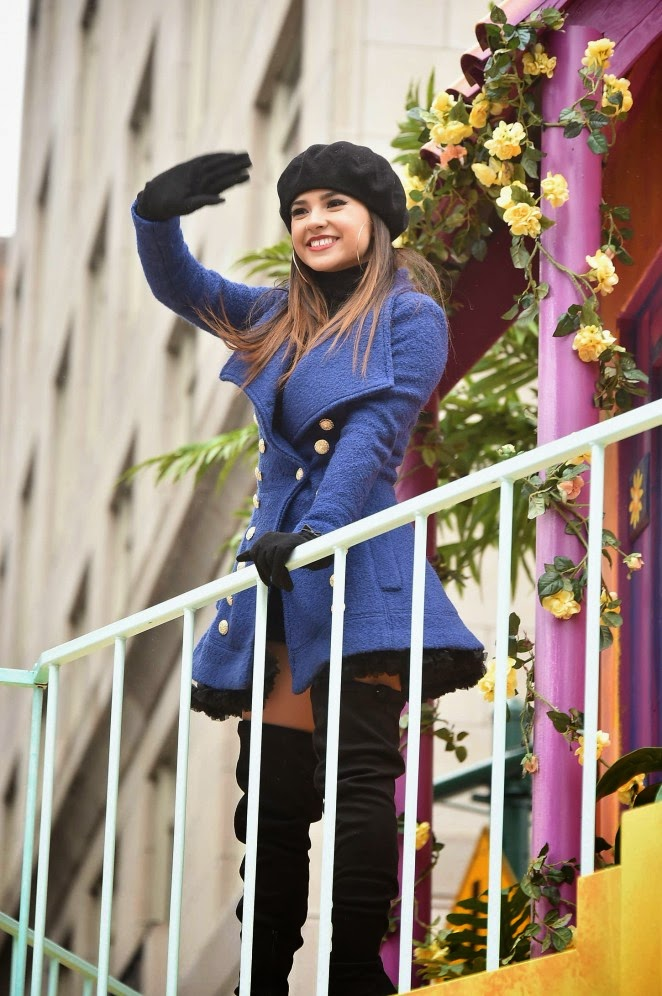Becky G pairs short coat with thigh-high boots for the Macy's Annual Thanksgiving Parade in NYC
