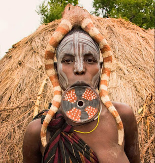 African lip plate ancient body modification art.
