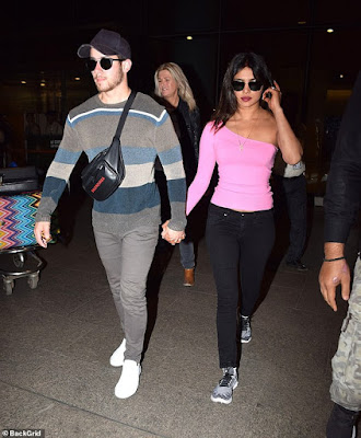 Priyanka Chopra stuns in a bright pink top as she arrives India with new husband