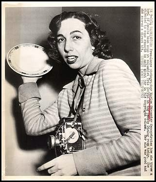 "An undated photo from Acme Telephoto: ""Free-lance photographer Marion Carpenter demonstrates how she threw a bowl of Senate bean soup at columnist Tris Coffin in the Senate Dining room today. She objected to some remarks he made about her in his copyright column. Her aim was good and she scored a direct hit."""