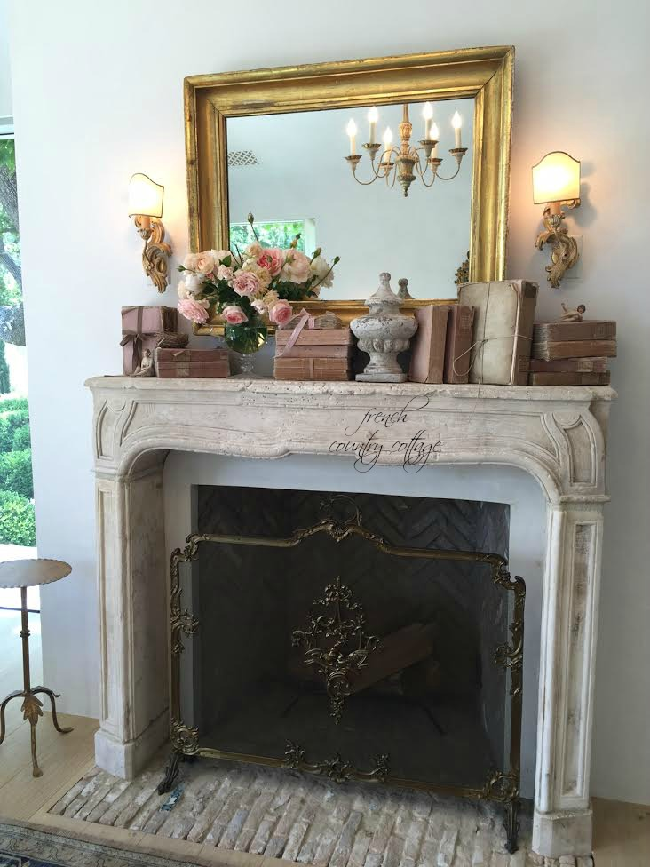 An afternoon at patina farm french country cottage for Farmhouse fireplace decor