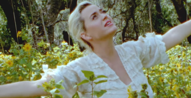 Katy Perry bares her growing bump in new music video 'Daisies'