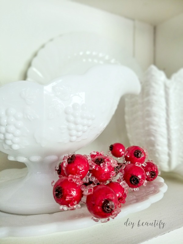 milk glass and red berries