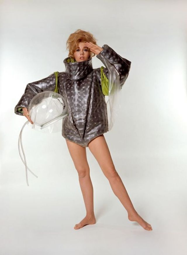 a shiny silver spacesuit with detachable sleeves and leggings with a transforming silver helmet worn for the title sequence as barbarella enters the