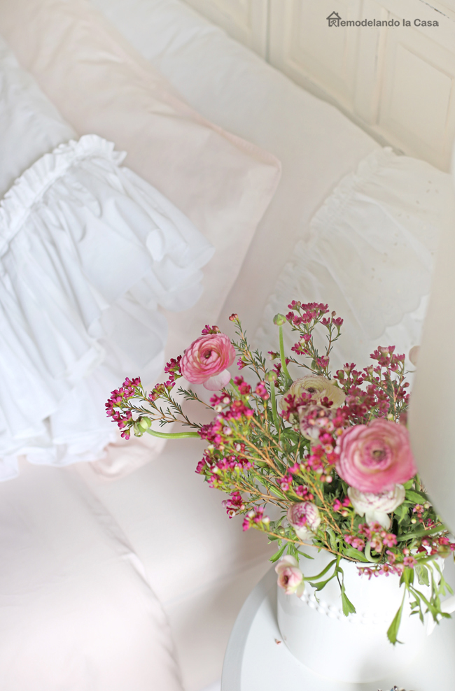 ranunculus and waxflowers bouquet by the side of the bed.