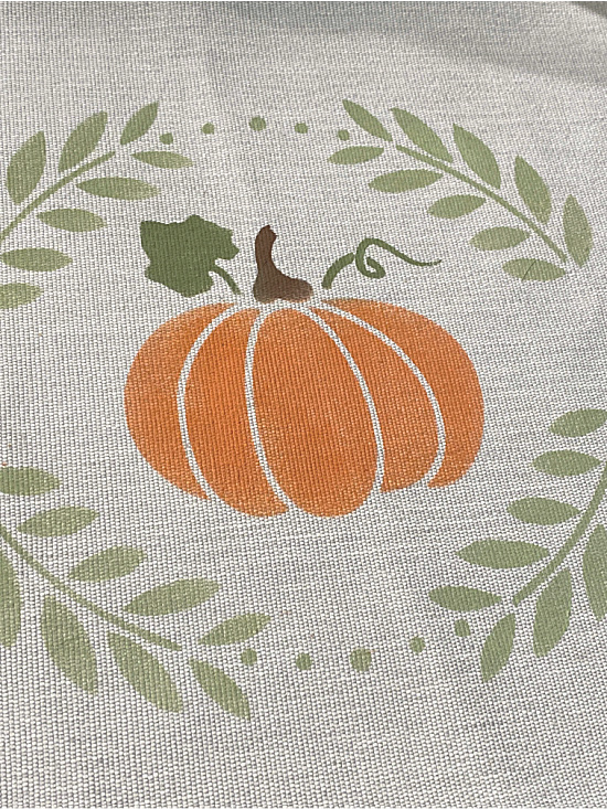 pumpkin and wreath stencil on a placemat