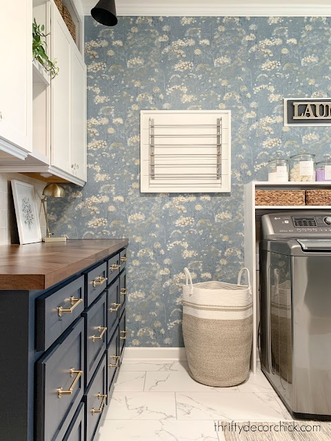 blue floral wallpaper laundry room