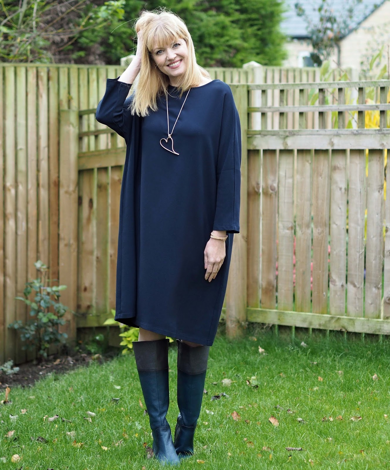 Crepe navy cocoon dress with navy and brown leather knee high boots, over 40 style