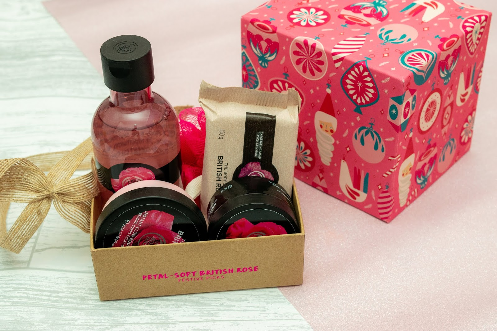 A selection of soap, scrubs, shower gels in pink packaging.