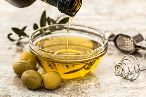 Olive oil is applied to skin and hair