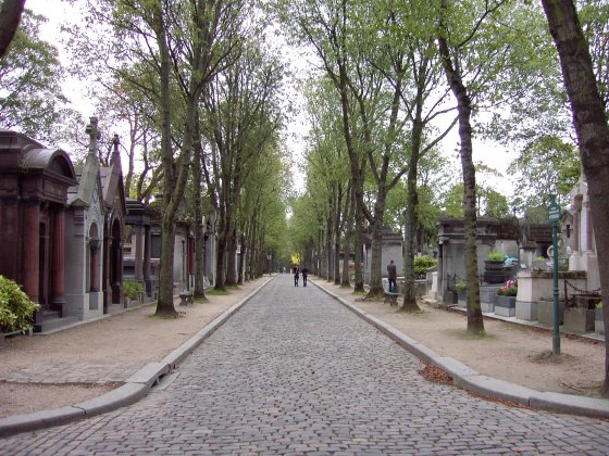Walking down a cobblestone road in Père Lachaise Cemetery, Paris, France