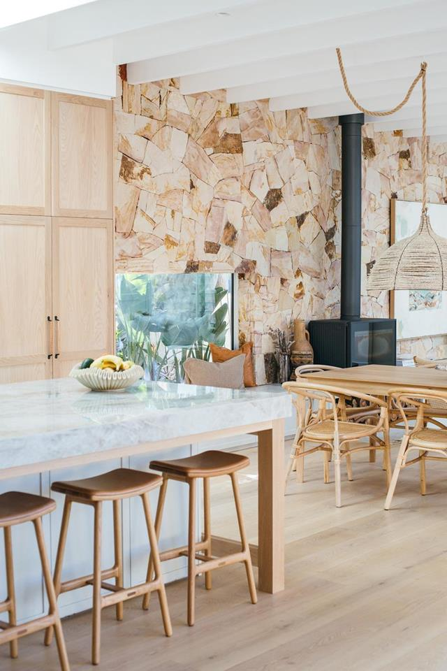 Sandstone accent wall near kitchen and dining room