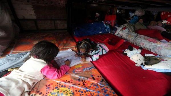 Niños migrantes retenidos por Estados Unidos llegan a 12.800