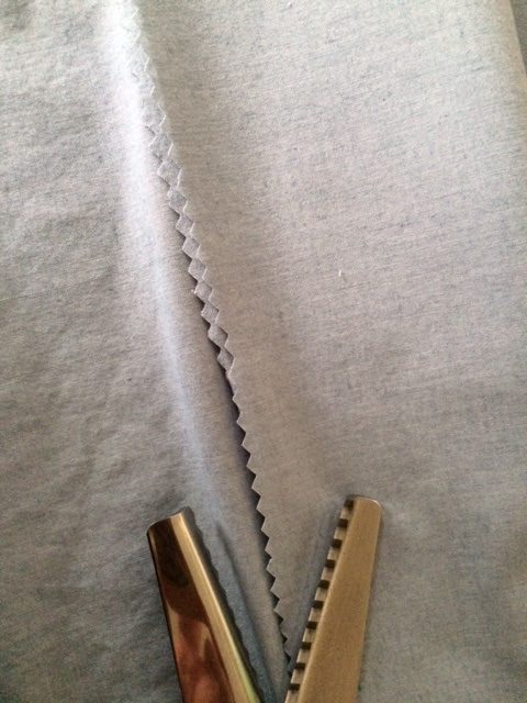 Pinking scissors cutting fabric