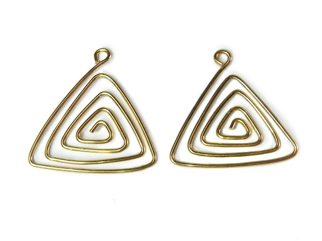 Two wire spiral triangles, approximately the same shape and size.