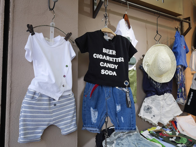 "children clothing with the words ""BEER CIGARETTES CANDY SODA"""