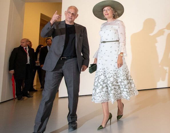 Queen Mathilde wore an embroidered tulle midi dress by Natan. Natan is a fashion house by Edouard Vermeulen. Queen Elizabeth