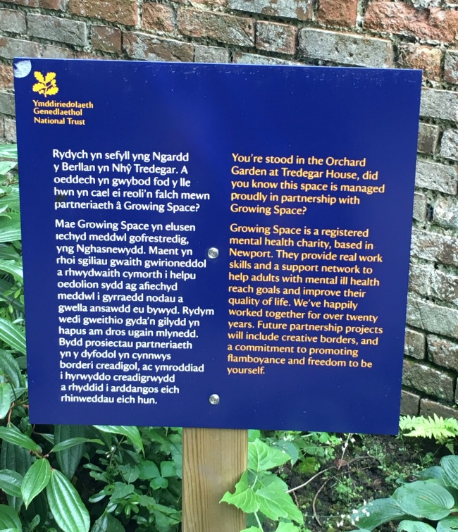 sign-stating-that-gardens-are-tended-by-workers-from-growing-space-charity