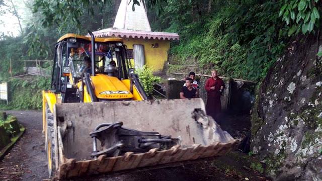 Excavator in nalidara to Labdah division shiva mandir road repairing