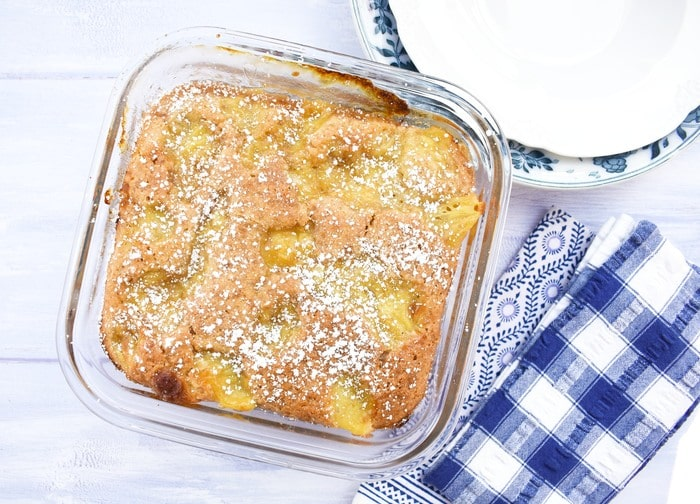 Baked rhubarb and custard sponge pudding in a square glass dish