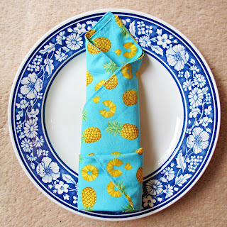 image handmade dinner napkin cuffed roll napkin fold pineapple pineapple slices domum vindemia riley blake fabric blue yellow