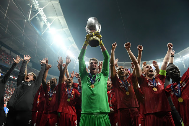 Liverpool players lift 2019 UEFA Super Cup trophy after beating Chelsea on penalties
