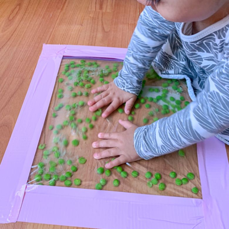 activities for babies - green pea sensory bag