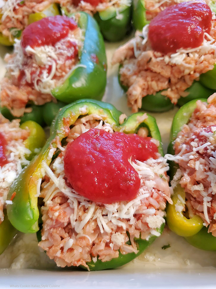 this is a chicken stuffed pepper topped with cheeses and tomato sauce