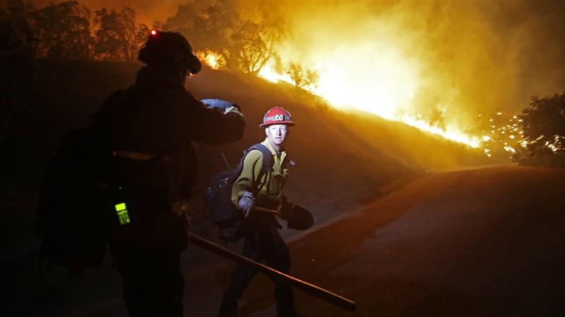 California: Crews make progress as winds subside