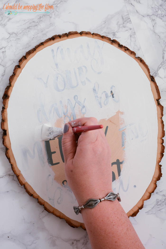 Christmas Wood Slice Art | Tutorial to create a fun and festive piece of holiday decor out of a wood slice.