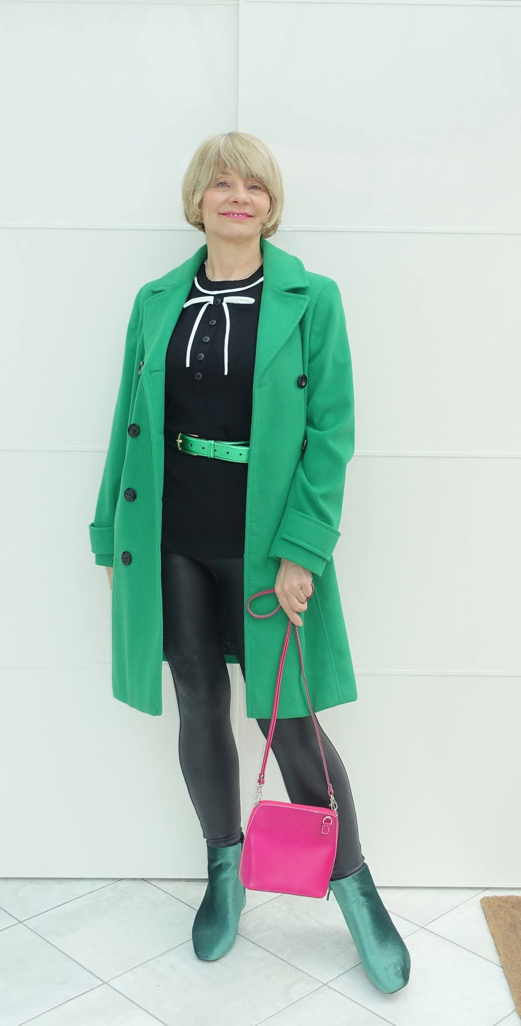 Faced with the challenge Faux Leather, Is This Mutton's Gail Hanlon remembered she has a pair of Spanx faux leather leggings. These she styled with a green coat, boots and belt, and black Peter Pan collar top with pink bag