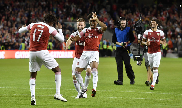 Arsenal players celebrate after Alex Iwobi's winning penalty after a penalty shoot out during the Pre-season friendly International Champions Cup game between Arsenal and Chelsea at Aviva stadium on August 1, 2018 in Dublin, Ireland.