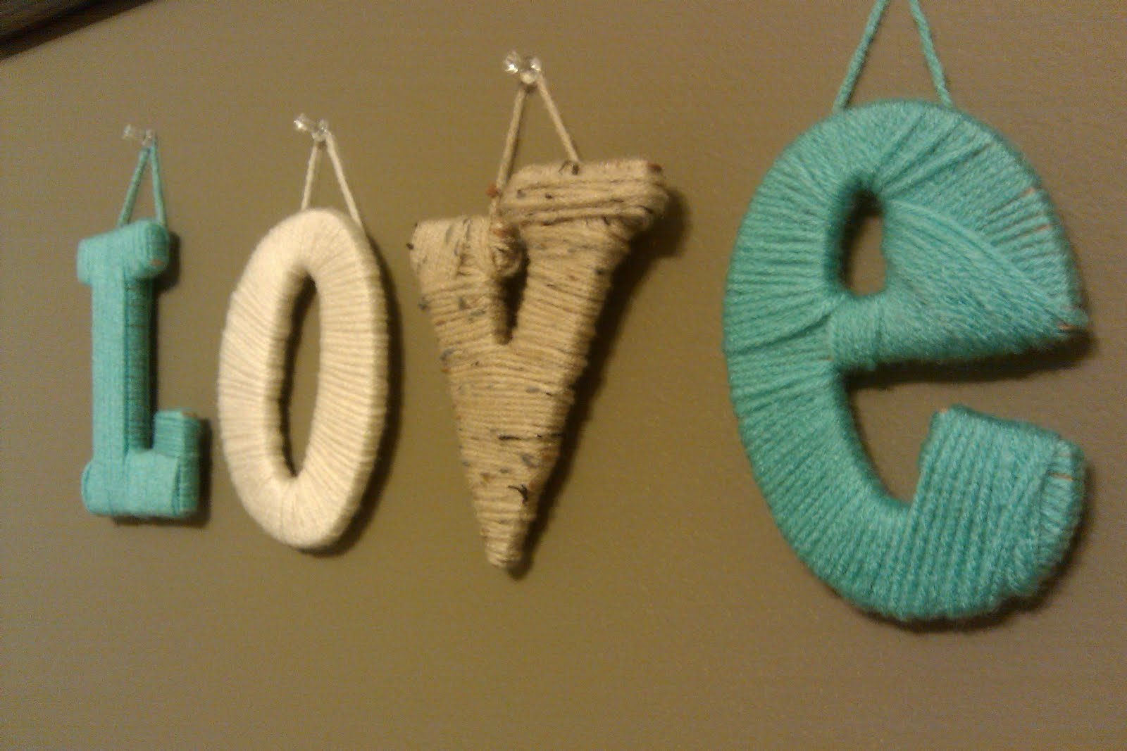 wooden letters covered in yarn Yarn-wrapped letters are an easy way to add a festive flair to wooden letters i used five different colors of yarn, so i covered 1/5 of each letter with each.