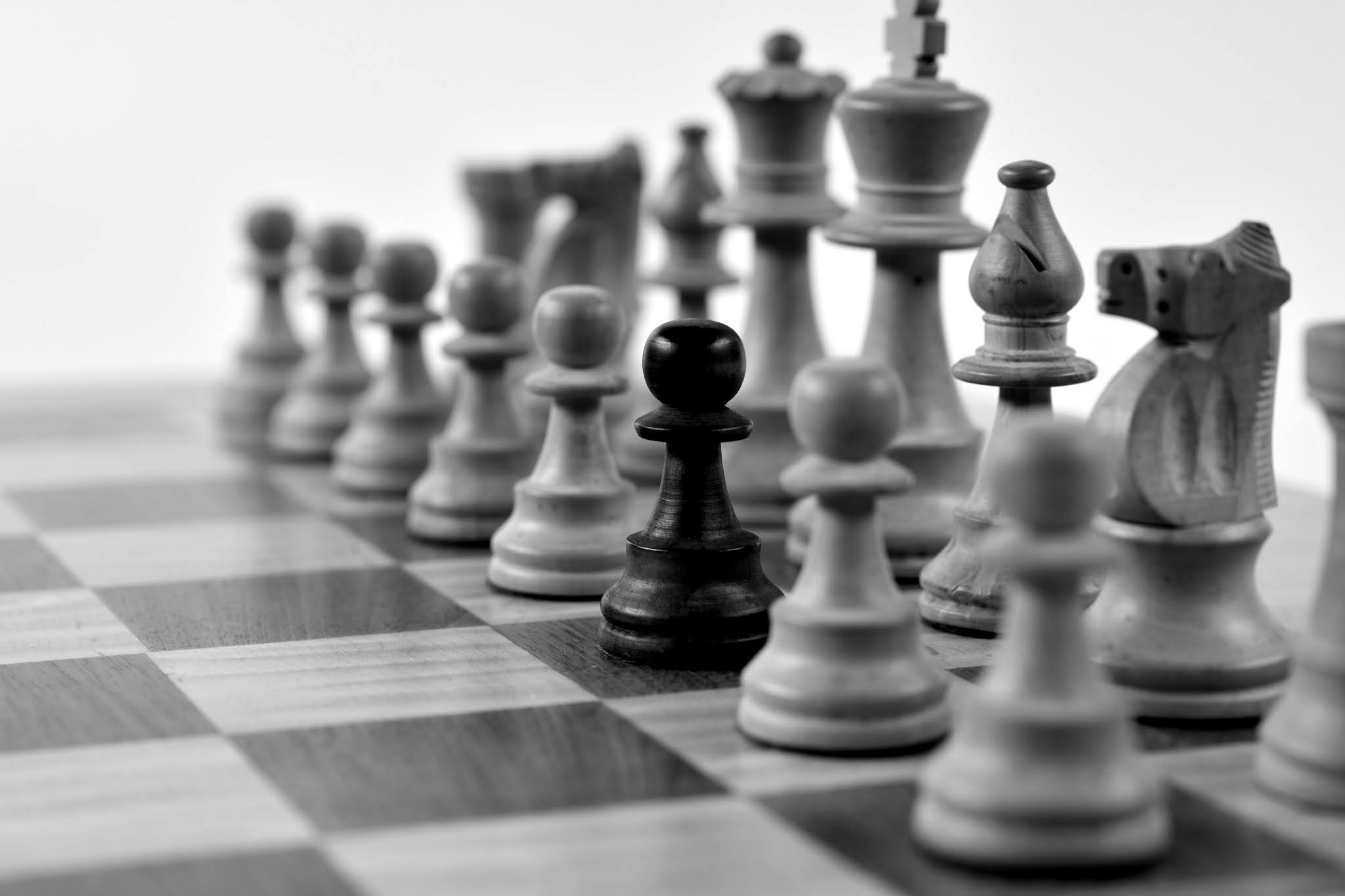 Black pawn among White chess pieces, Odd one out