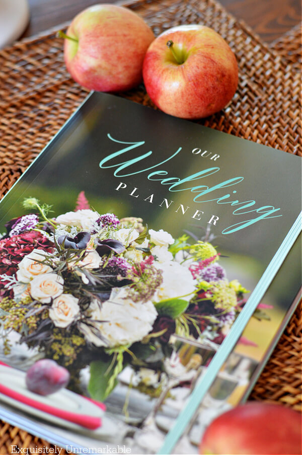 Our Wedding Planner Alda Ellis on a table with apples
