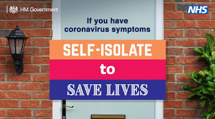 Self isolate to save lives UK Government advert with closed door behind text